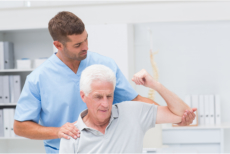 A caregiver assisting an elderly during their physical therapy session